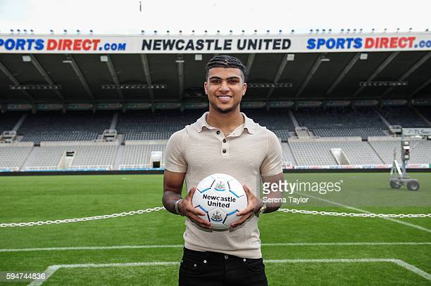 DeAndre Yedlin holds a football pitch side after signing a 5 year contract at StJames' Park on August 24 in Newcastle upon Tyne England