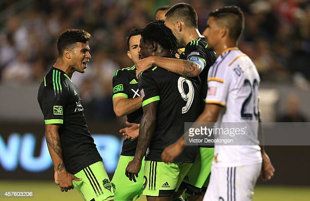 DeAndre Yedlin Marco Pappa and Clint Dempsey of Seattle Sounders FC congratulate jubilant teammate Obafemi Martins after Martins scored a goal to tie...