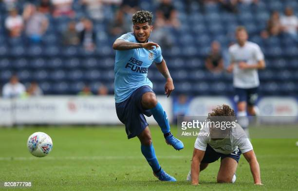 Deandre Yedlin of Newcastle United beats Ben Pearson of Preston North End during a preseason friendly match between Preston North End and Newcastle...