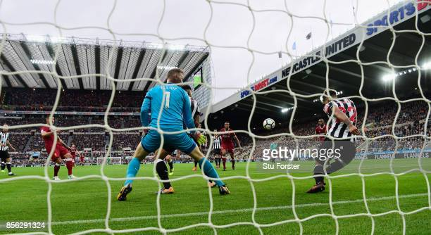 DeAndre Yedlin of Newcastle United clears a Liverpool shot off the goalline during the Premier League match between Newcastle United and Liverpool at...