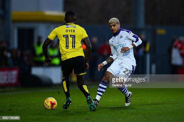 DeAndre Yedlin of Newcastle United passes the ball past Lloyd Dyer of Burton Albion during the Sky Bet Championship match between Burton Albion and...