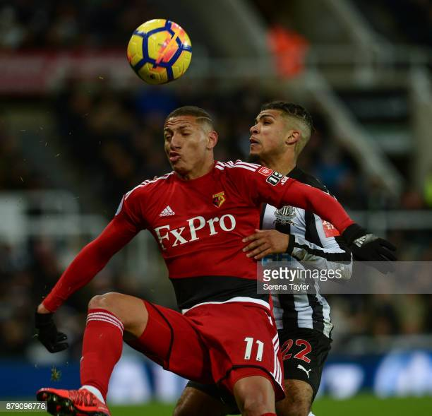 DeAndre Yedlin of Newcastle Untited jostles for the ball with Richarlison of Watford during the Premier League match between Newcastle United and...