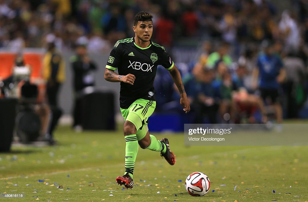 DeAndre Yedlin #17 of Seattle Sounders FC paces the ball on the attack during the MLS match against the Los Angeles Galaxy at StubHub Center on October 19, 2014 in Los Angeles, California. The Sounders and Galaxy played to a 2-2 draw.