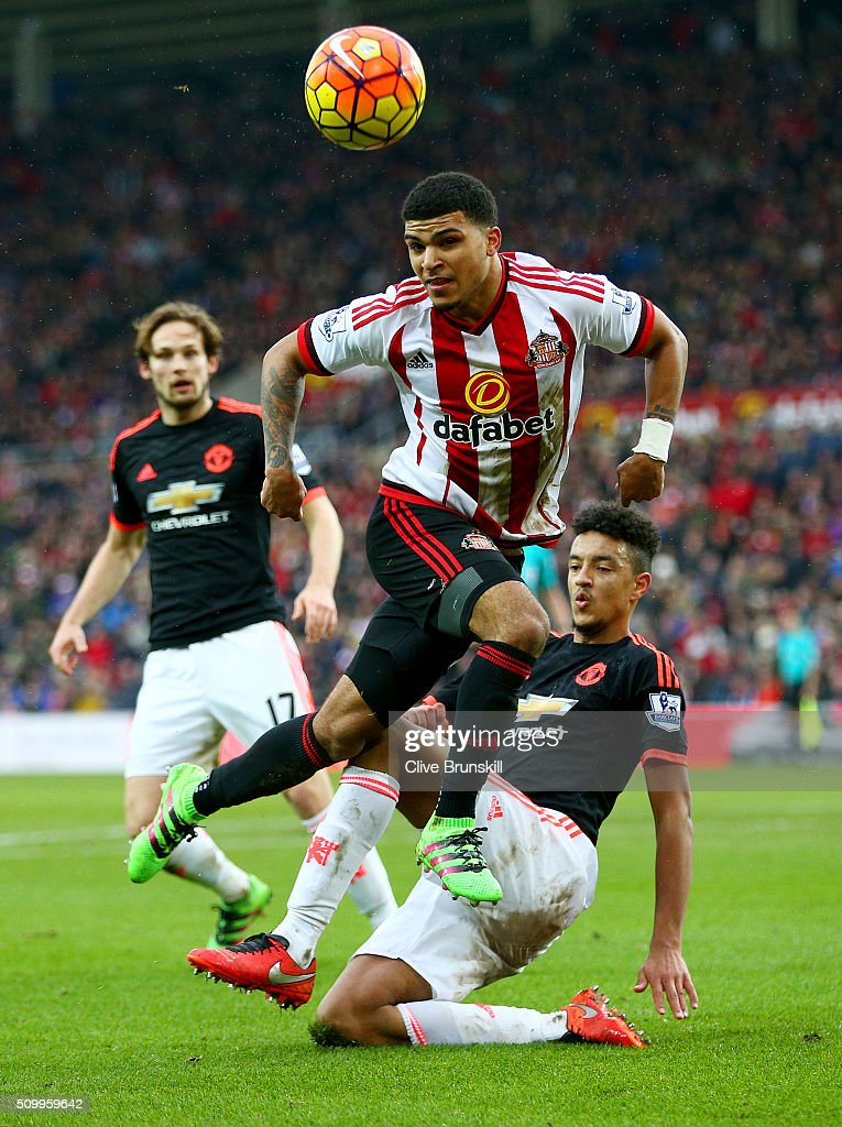 <a gi-track='captionPersonalityLinkClicked' href=/galleries/search?phrase=DeAndre+Yedlin&family=editorial&specificpeople=10292103 ng-click='$event.stopPropagation()'>DeAndre Yedlin</a> of Sunderland is tackled by Cameron Borthwick-Jackson of Manchester United during the Barclays Premier League match between Sunderland and Manchester United at the Stadium of Light on February 13, 2016 in Sunderland, England.
