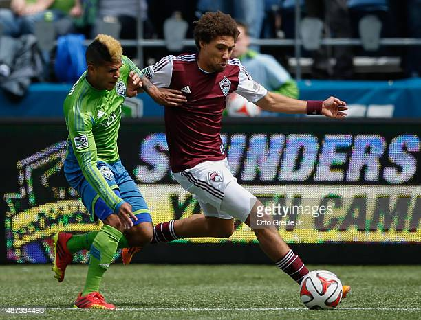 DeAndre Yedlin of the Seattle Sounders FC battles Chris Klute of the Colorado Rapids at CenturyLink Field on April 26 2014 in Seattle Washington The...