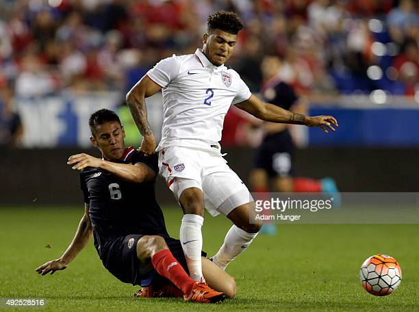 DeAndre Yedlin of the United States and Oscar Duarte of Costa Rica battle for the ball during the second half at Red Bull Arena on October 13 2015 in...