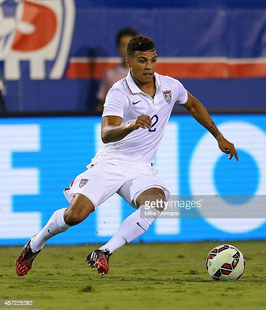 DeAndre Yedlin of the USA brings the ball upfield during a game against Honduras at FAU Stadium on October 14 2014 in Boca Raton Florida