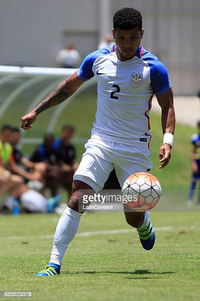 DeAndre Yedlin of USA drives the ball during an international friendly match between Puerto Rico and USA at Juan Ramon Loubriel Stadium on May 22...