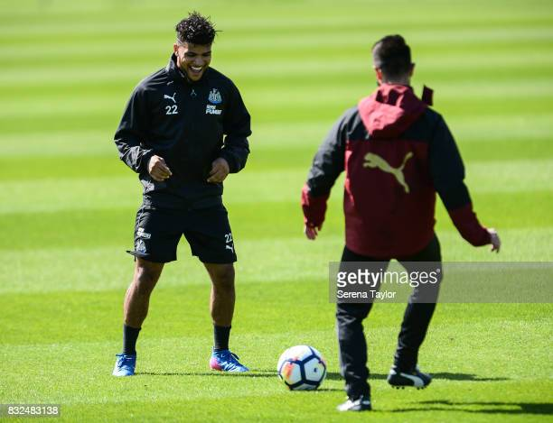 DeAndre Yedlin passes the ball with Rehabilitation Coach Cristian Fernandez Martinez during the Newcastle United Training session at the Newcastle...