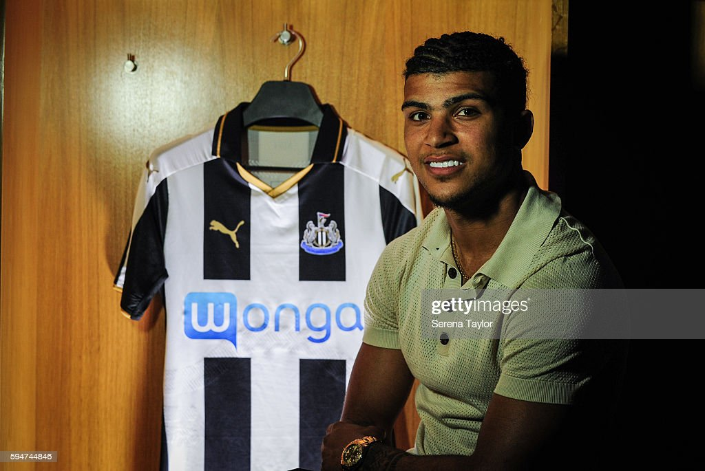 DeAndre Yedlin poses for a photograph in the dressing room with a club shirt after signing a 5 year contract at StJames' Park on August 24 in...