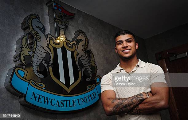 DeAndre Yedlin poses for photographs with the club crest after signing a 5 year contract at StJames' Park on August 24 in Newcastle upon Tyne England