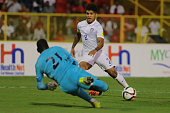 DeAndre Yedlin runs into the box as TT goalkeeper Jan Michael Williams dives to save the ball during a World Cup Qualifier between Trinidad and...