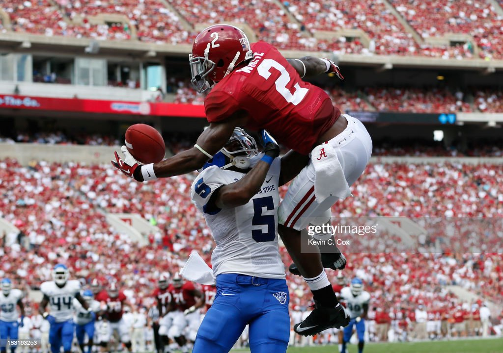 DeAndrew White #2 of the Alabama Crimson Tide pulls in this touchdown reception against Demarius Matthews #5 of the Georgia State Panthers at Bryant-Denny Stadium on October 5, 2013 in Tuscaloosa, Alabama.
