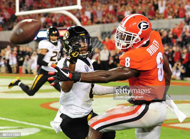 Deangelo Gibbs of the Missouri Tigers breaks up a pass for Riley Ridley of the Georgia Bulldogs at Sanford Stadium on October 14 2017 in Athens...