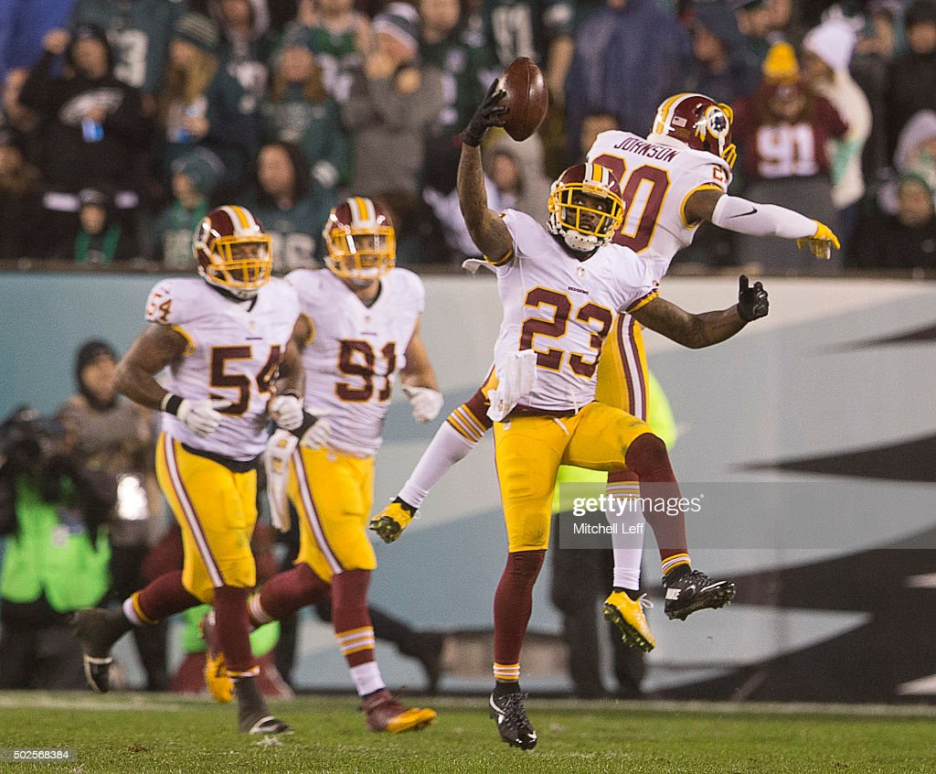 DeAngelo Hall and Jeron Johnson of the Washington Redskins celebrate after a fumble recovery for a touchdown by DeAngelo Hall against the...