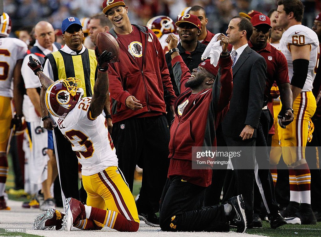 DeAngelo Hall #23 of the Washington Redskins celebrates on the sidelines after intercepting a pass from Tony Romo #9 of the Dallas Cowboys on Thanksgiving Day at Cowboys Stadium on November 22, 2012 in Arlington, Texas.