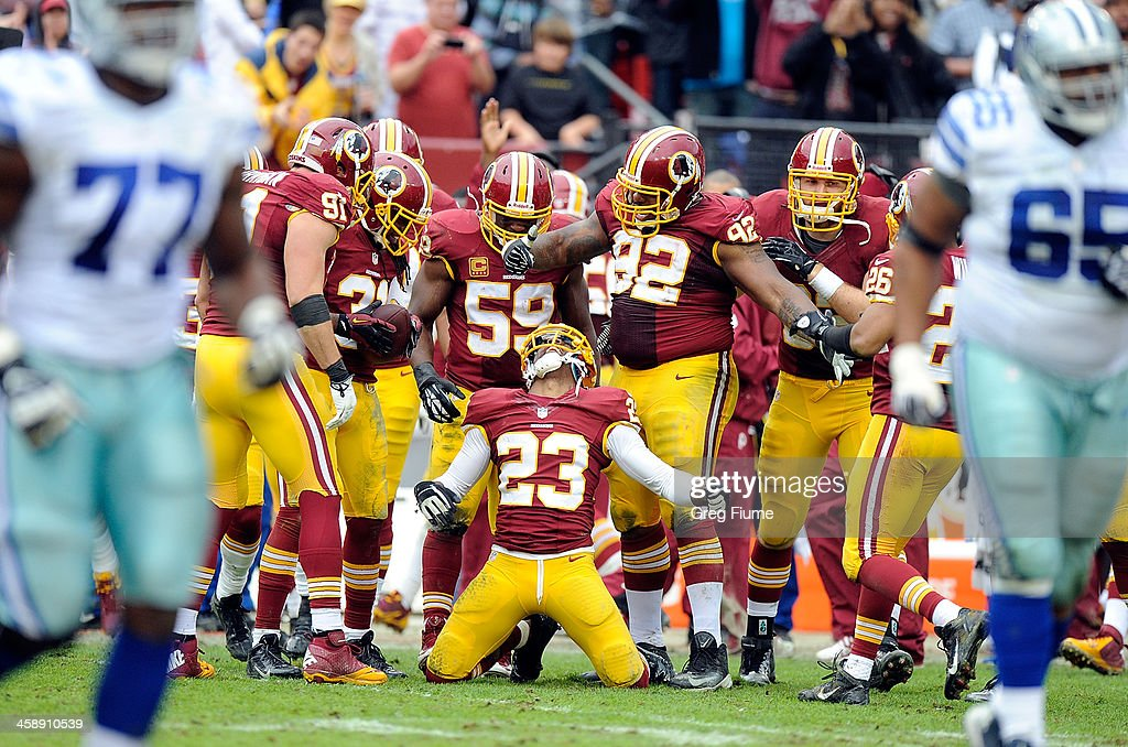 DeAngelo Hall of the Washington Redskins celebrates with teammates after making an interception in the third quarter against the Dallas Cowboys at...