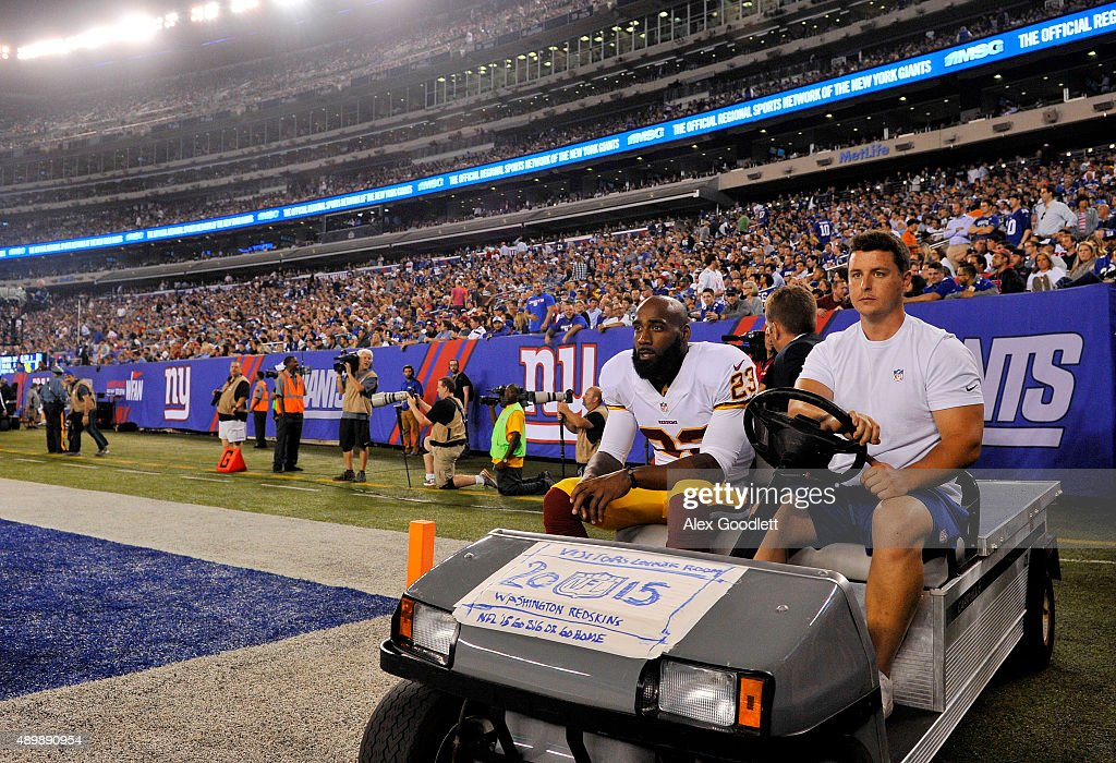 DeAngelo Hall of the Washington Redskins is carted off of the field after being injured during their game against the New York Giants at MetLife...