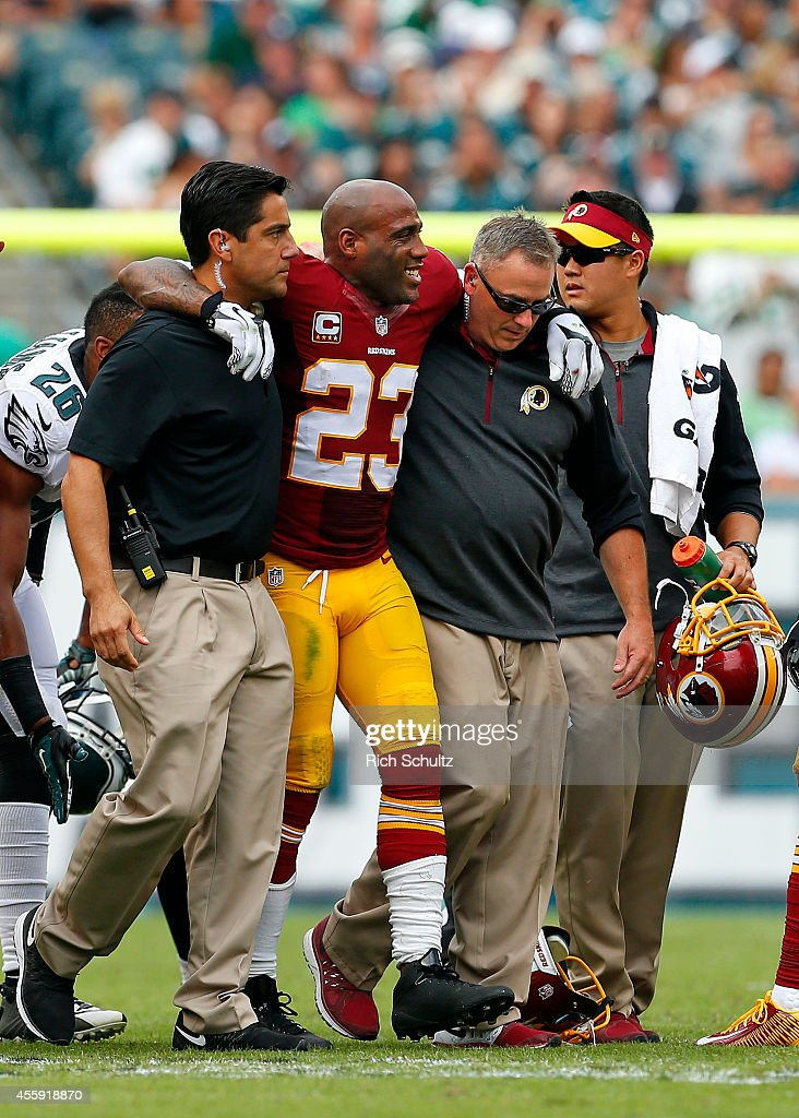 DeAngelo Hall of the Washington Redskins is helped off the field by medical personal during the third quarter of a game against the Philadelphia...