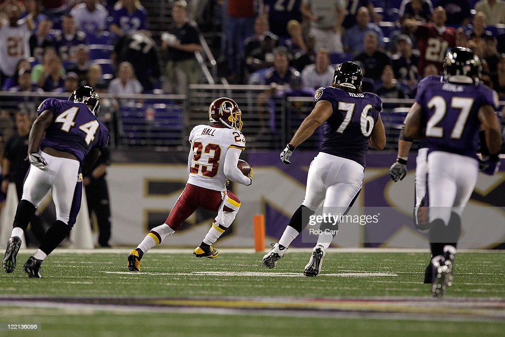 <a gi-track='captionPersonalityLinkClicked' href=/galleries/search?phrase=DeAngelo+Hall&family=editorial&specificpeople=209065 ng-click='$event.stopPropagation()'>DeAngelo Hall</a> #23 of the Washington Redskins returns an interception for a touchdown against the Baltimore Ravens during the first half of a preaseason game at M&T Bank Stadium on August 25, 2011 in Baltimore, Maryland.