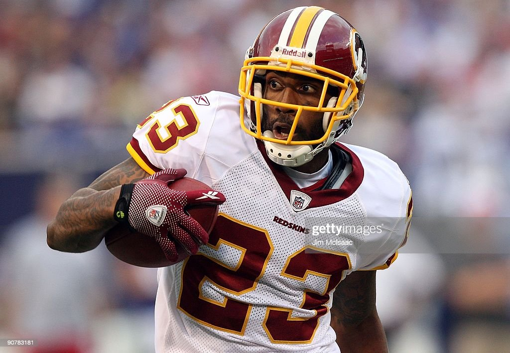 DeAngelo Hall of the Washington Redskins runs the ball after an interception against the New York Giants on September 13 2009 at Giants Stadium in...