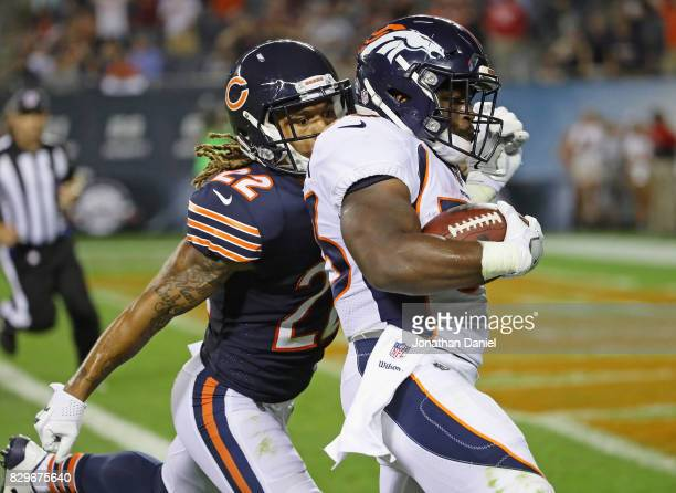 De'Angelo Henderson of the Denver Broncos runs past Cre'von LeBlanc of the Chicago Bears for the game winning touchdown during a preseason game at...