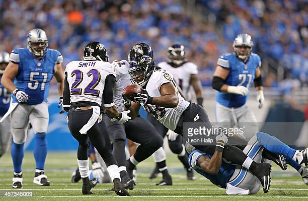DeAngelo Tyson of the Baltimore Ravens intercepts Matthew Stafford of the Detroit Lions during the third quarter of the game at Ford Field on...