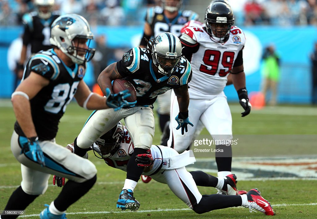 DeAngelo Williams #34 of the Carolina Panthers runs for a touchdown during their game against the Atlanta Falcons at Bank of America Stadium on December 9, 2012 in Charlotte, North Carolina.