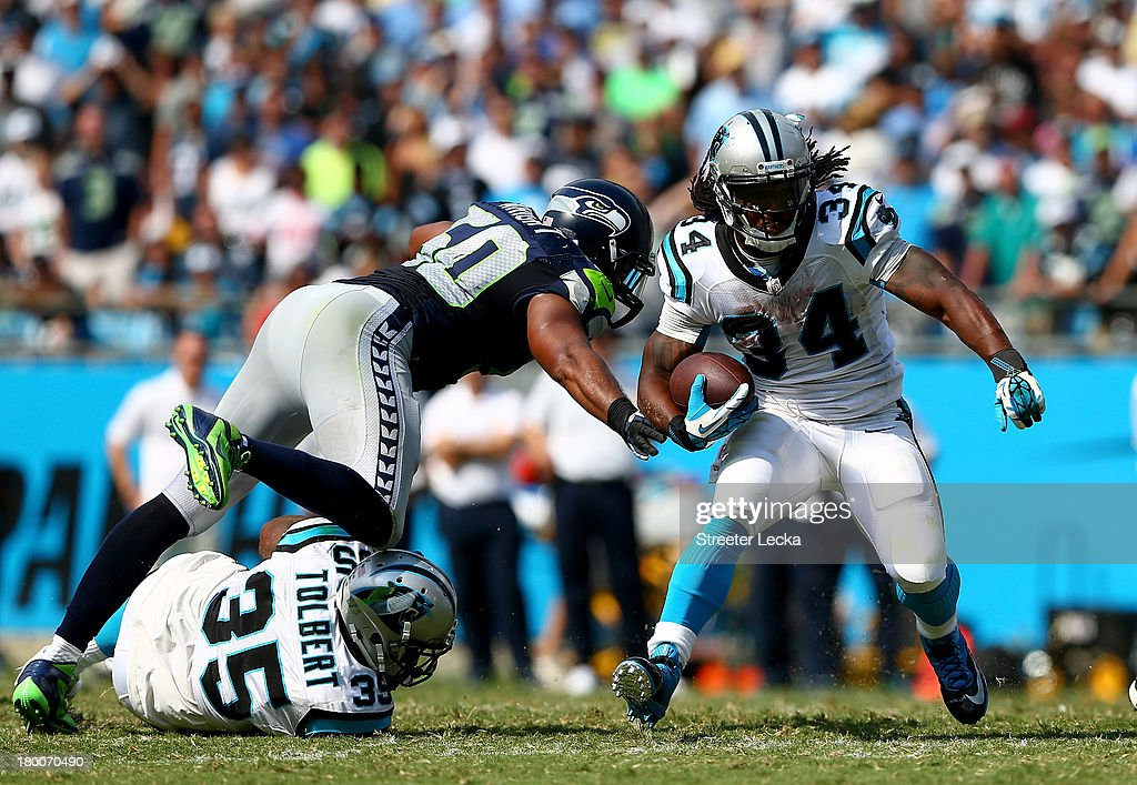 <a gi-track='captionPersonalityLinkClicked' href=/galleries/search?phrase=DeAngelo+Williams&family=editorial&specificpeople=618130 ng-click='$event.stopPropagation()'>DeAngelo Williams</a> #34 of the Carolina Panthers runs with the ball against the Seattle Seahawks during their game at Bank of America Stadium on September 8, 2013 in Charlotte, North Carolina.