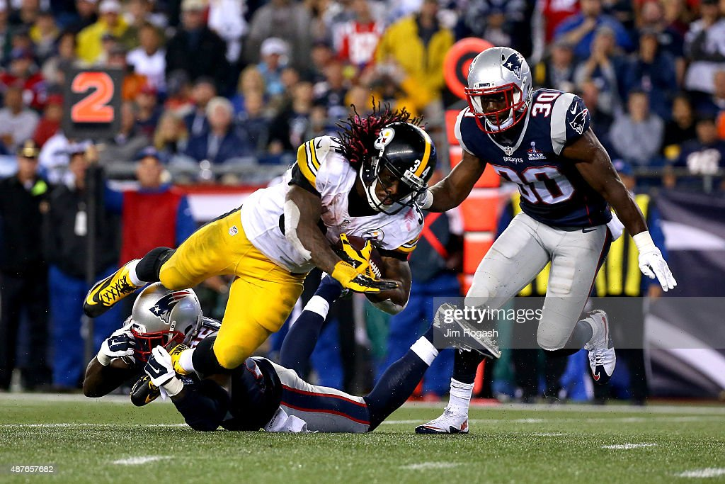 DeAngelo Williams #34 of the Pittsburgh Steelers is tackled after a run by Devin McCourty #32 of the New England Patriots in the second half at Gillette Stadium on September 10, 2015 in Foxboro, Massachusetts.