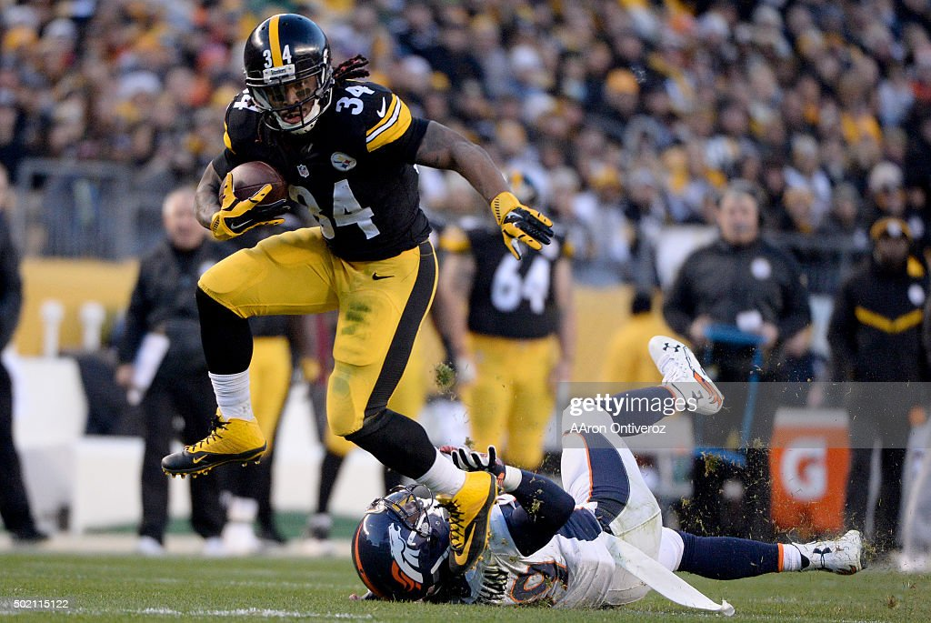 DeAngelo Williams (34) of the Pittsburgh Steelers trucks Danny Trevathan (59) of the Denver Broncos during the first half of play at Heinz Field. The Pittsburgh Steelers hosted the Denver Broncos on Sunday, December 20, 2015.