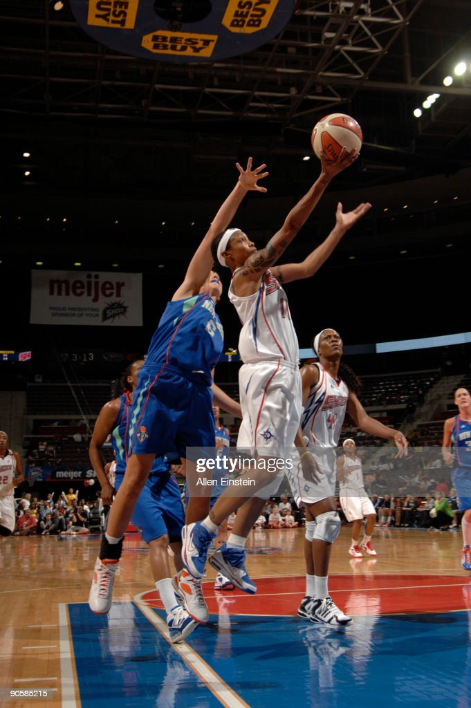 Deanna Nolan #14 of the Detroit Shock goes up for a layup past Sidney Spencer #6 of the New York Liberty on September 10, 2009 at The Palace of Auburn Hills in Auburn Hills, Michigan.
