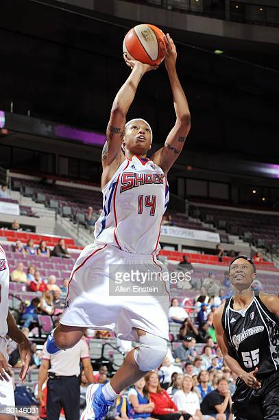 Deanna Nolan of the Detroit Shock goes up for a shot during the game against the San Antonio Silver Stars at the Palace of Auburn Hills on August 23...