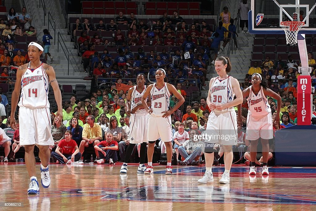 Deanna Nolan Sheri Sam Plenette Pierson Katie Smith and Kara Braxton of the Detroit Shock stand on the court during the WNBA game against the Chicago...