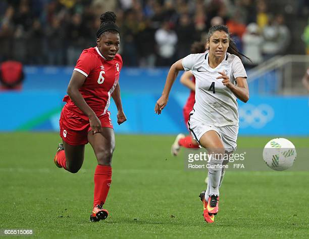 Deanne Rose of Canada and Sakina Karchaoui of France chase the ball during the Women's Football Quarter Final match between Canada and France on Day...