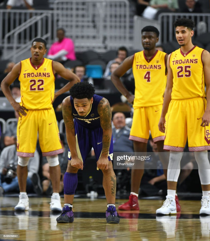 De'Anthony Melton #22, Chimezie Metu #4 and Bennie Boatwright #25 of the USC Trojans look on as David Crisp #1 of the Washington Huskies reacts after missing a 3-pointer that would have tied the game with seconds left in a first-round game of the Pac-12 Basketball Tournament at T-Mobile Arena on March 8, 2017 in Las Vegas, Nevada. USC won 78-73.