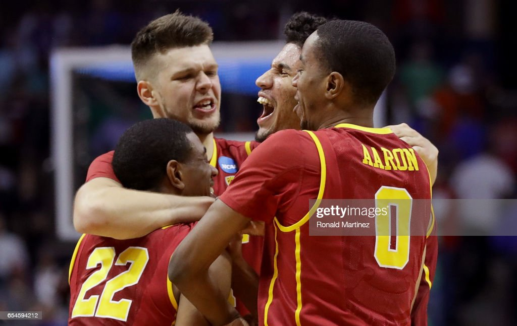 De'Anthony Melton #22, Nick Rakocevic #31, Bennie Boatwright #25 and Shaqquan Aaron #0 of the USC Trojans celebrate after defeating the Southern Methodist Mustangs during the first round of the 2017 NCAA Men's Basketball Tournament at BOK Center on March 17, 2017 in Tulsa, Oklahoma.