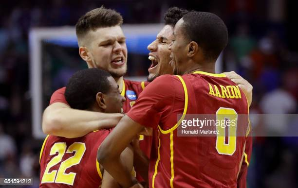 De'Anthony Melton Nick Rakocevic Bennie Boatwright and Shaqquan Aaron of the USC Trojans celebrate after defeating the Southern Methodist Mustangs...
