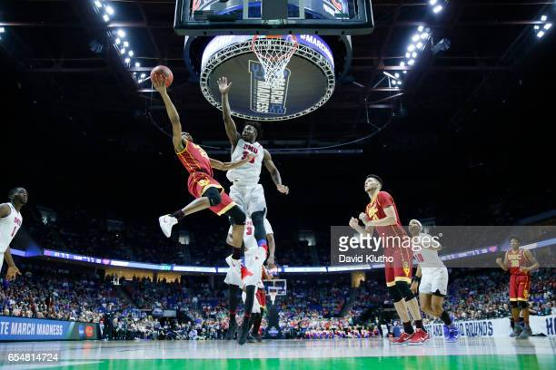 De'Anthony Melton of the USC Trojans attempts a shot over Semi Ojeleye of the Southern Methodist Mustangs during the 2017 NCAA Men's Basketball...