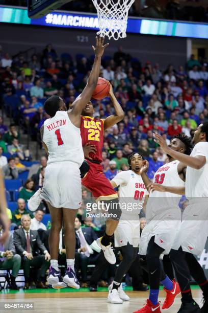 De'Anthony Melton of the USC Trojans attempts a shot with pressure from Shake Milton of the Southern Methodist Mustangs during the 2017 NCAA Men's...