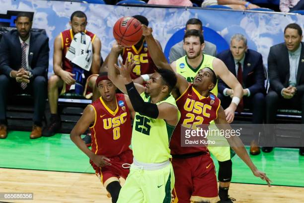 De'Anthony Melton of the USC Trojans blocks Al Freeman of the Baylor Bears during the 2017 NCAA Men's Basketball Tournament held at BOK Center on...