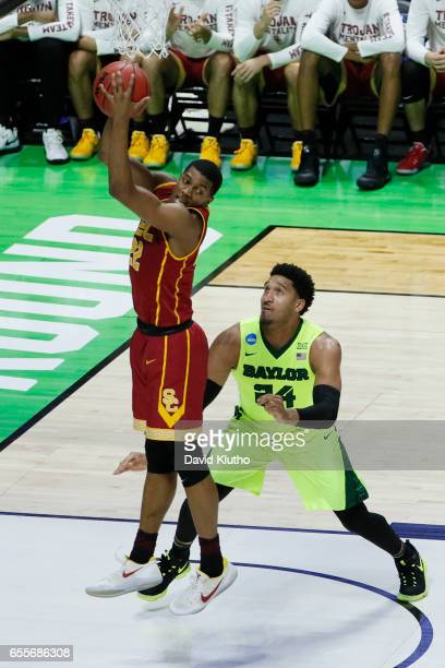 De'Anthony Melton of the USC Trojans brings down a rebound over Ishmail Wainright of the Baylor Bears during the 2017 NCAA Men's Basketball...