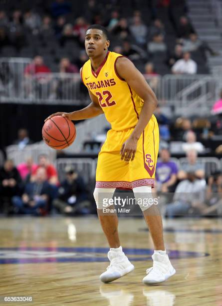De'Anthony Melton of the USC Trojans brings the ball up the court against the Washington Huskies during a firstround game of the Pac12 Basketball...