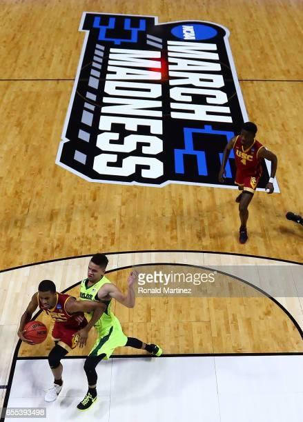 De'Anthony Melton of the USC Trojans dribbles the ball past Manu Lecomte of the Baylor Bears during the second round of the 2017 NCAA Men's...