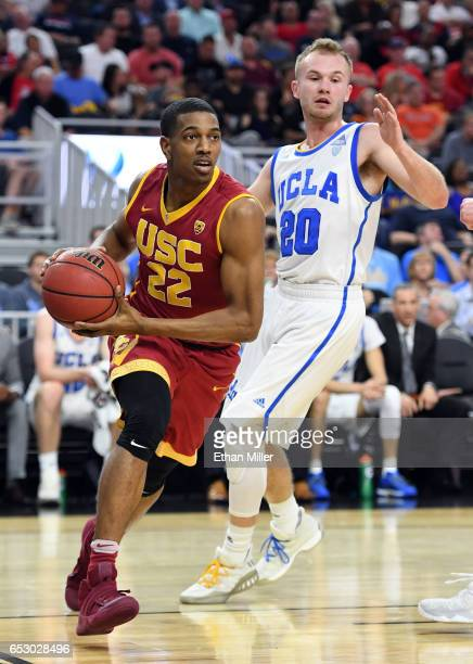 De'Anthony Melton of the USC Trojans drives ahead of Bryce Alford of the UCLA Bruins during a quarterfinal game of the Pac12 Basketball Tournament at...