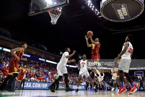 De'Anthony Melton of the USC Trojans drives to the basket in the second half against the Southern Methodist Mustangs during the first round of the...