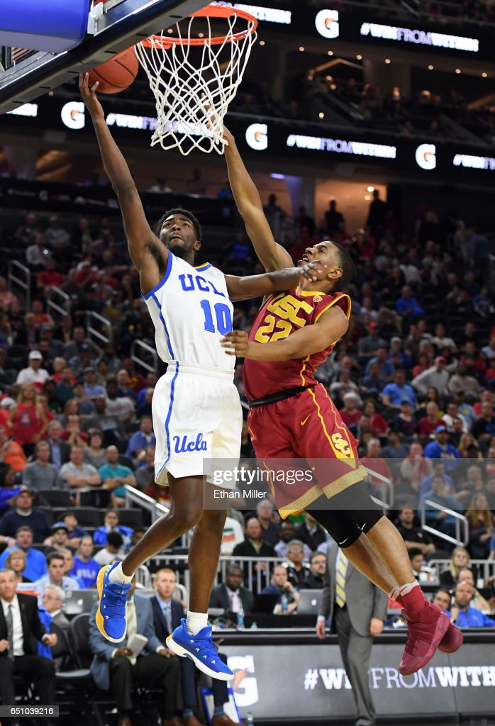 De'Anthony Melton #22 of the USC Trojans fouls Isaac Hamilton #10 of the UCLA Bruins as he scores on a layup during a quarterfinal game of the Pac-12 Basketball Tournament at T-Mobile Arena on March 9, 2017 in Las Vegas, Nevada. UCLA won 76-74.