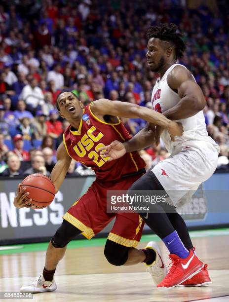 De'Anthony Melton of the USC Trojans handles the ball against Semi Ojeleye of the Southern Methodist Mustangs in the second half during the first...