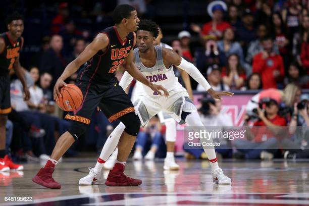 De'Anthony Melton of the USC Trojans is defended by Kobi Simmons of the Arizona Wildcats during the second half of the college basketball game at...