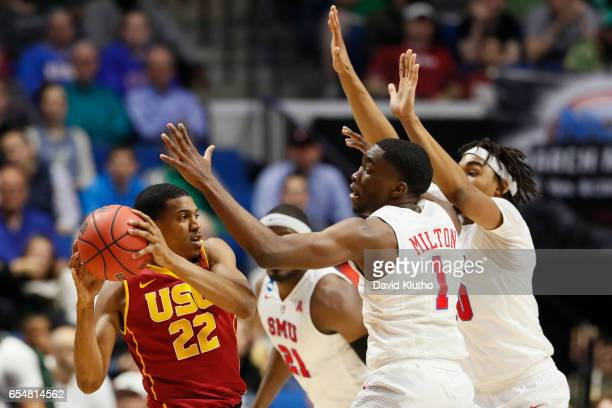 De'Anthony Melton of the USC Trojans looks for an open teammate over Shake Milton and Ben Moore of the Southern Methodist Mustangs during the 2017...